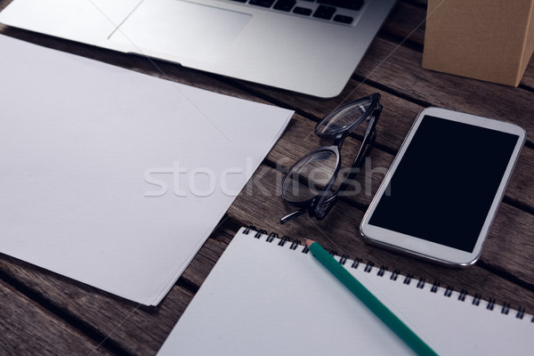 Stock photo: Close-up of electronic gadgets and office supplies on wooden table