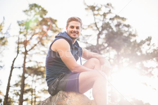 Fiatal boldog kocogó ül kő néz Stock fotó © wavebreak_media