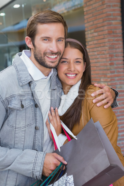 Young couple smiling while looking at the camera Stock photo © wavebreak_media