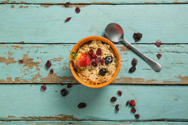 Bowls of wheaties cereal with fruits on wooden table Stock photo © wavebreak_media