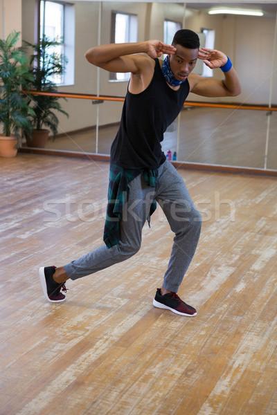 Full length of male dancer practicing at studio Stock photo © wavebreak_media