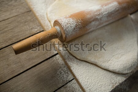 Cropped image of rolling pin on rolled dough over cutting board Stock photo © wavebreak_media