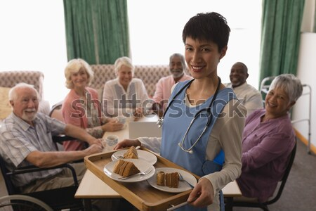 High angle view of teacher showing tablet while sitting with senior adults Stock photo © wavebreak_media