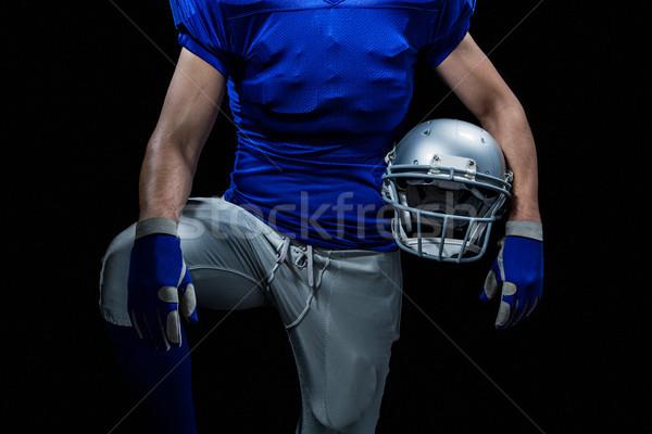 Mid section of sportsman holding helmet Stock photo © wavebreak_media