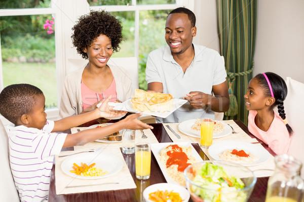 Família feliz alimentação juntos casa mulher menino Foto stock © wavebreak_media