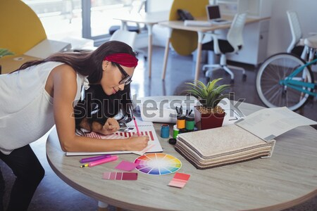 Female executive working on laptop while using virtual reality headset Stock photo © wavebreak_media