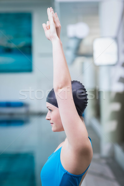 Fit woman raising arms Stock photo © wavebreak_media