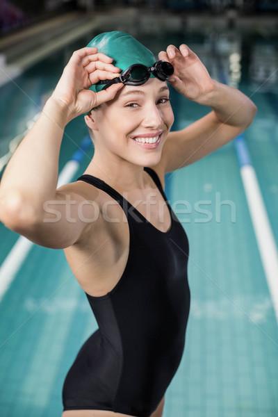 Donna costume da bagno occhiali piscina acqua felice Foto d'archivio © wavebreak_media