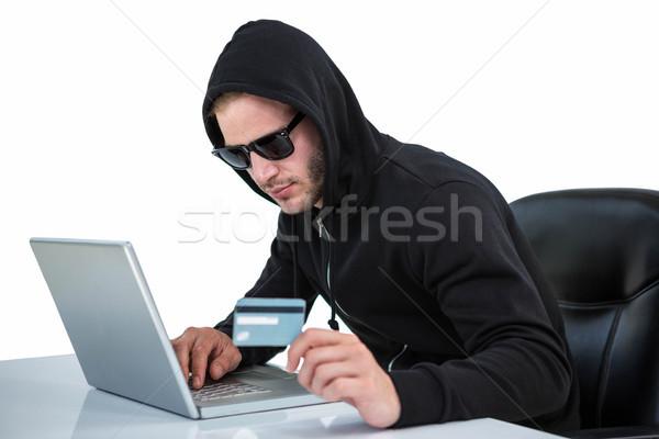 Man in black hoodie doing online shopping Stock photo © wavebreak_media