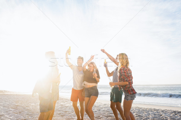 Boldog barátok tánc együtt tengerpart tenger Stock fotó © wavebreak_media