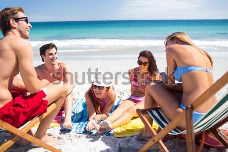 Rahatlatıcı konuşma plaj oturma koltuk Stok fotoğraf © wavebreak_media
