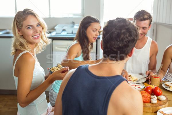 Sorridente mulher jovem café da manhã amigos casa retrato Foto stock © wavebreak_media