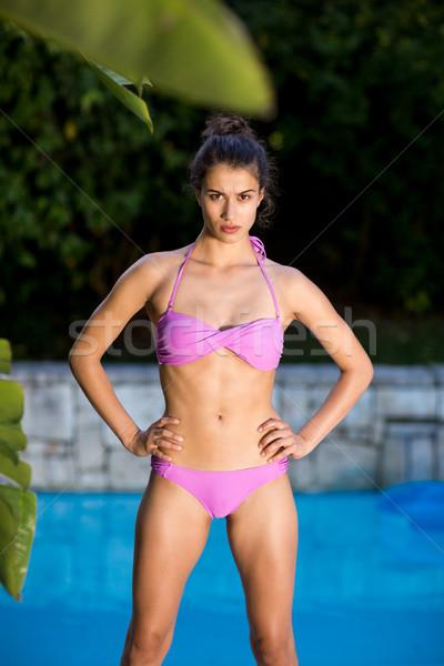 Beautiful woman standing at poolside Stock photo © wavebreak_media