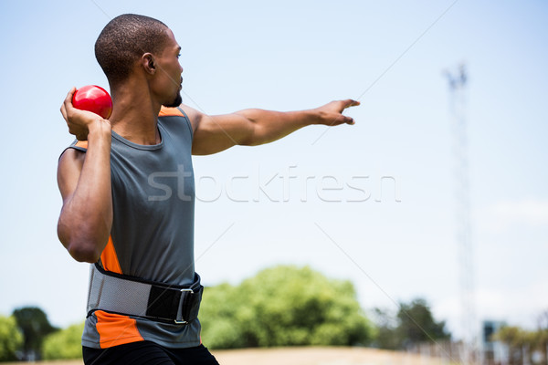 Male athlete about to throw shot put ball Stock photo © wavebreak_media