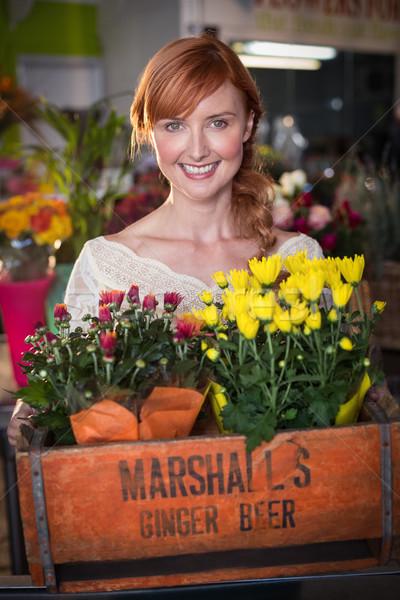 Female florist holding crate of flower bouquet Stock photo © wavebreak_media