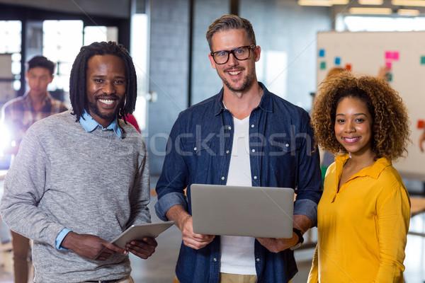 Portrait of colleagues standing in office Stock photo © wavebreak_media