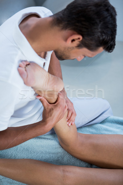 Jambe massage femme clinique bébé homme Photo stock © wavebreak_media