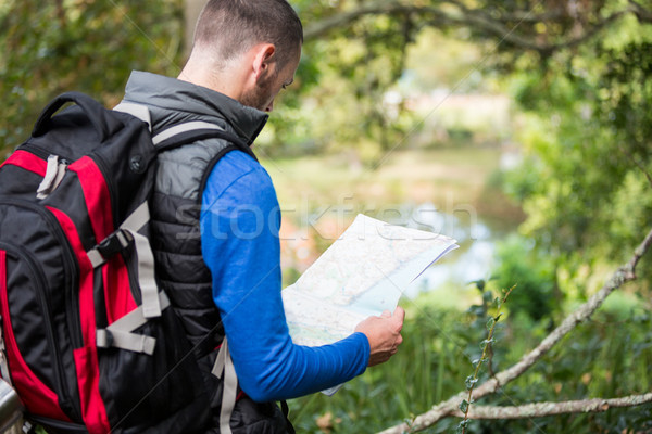Stock photo: Male hiker looking at map