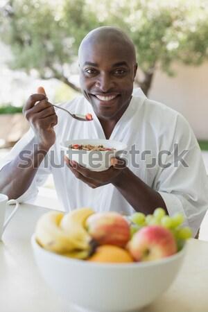 Senior couples removing seeds of apricot fruits in garden Stock photo © wavebreak_media