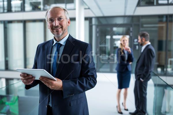 портрет бизнесмен цифровой таблетка коллеги Сток-фото © wavebreak_media