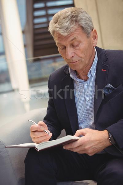 внимательный бизнесмен Дать организатор служба компьютер Сток-фото © wavebreak_media