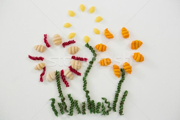 Varieties of pasta forming flower Stock photo © wavebreak_media