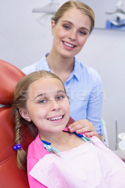 Sorridente mãe filha dental clínica mulher Foto stock © wavebreak_media