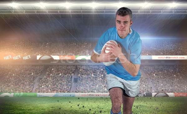 Composite image of rugby player running with the rugby ball Stock photo © wavebreak_media