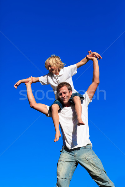 Apa fiú háton kék ég család mosoly Stock fotó © wavebreak_media