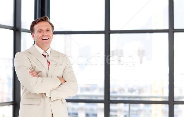 Smiling senior businessman with folded arms Stock photo © wavebreak_media