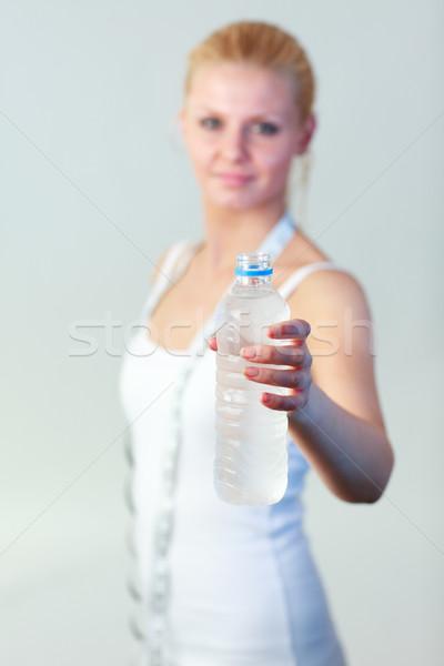 Amigável mulher garrafa água foco Foto stock © wavebreak_media