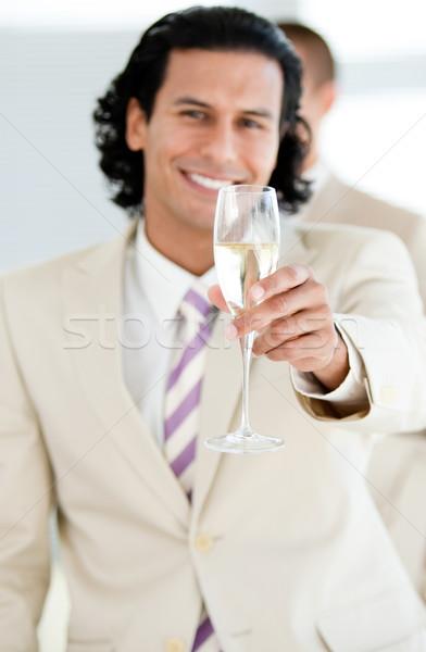 Cheerful businessman holding a glass of Champagne Stock photo © wavebreak_media