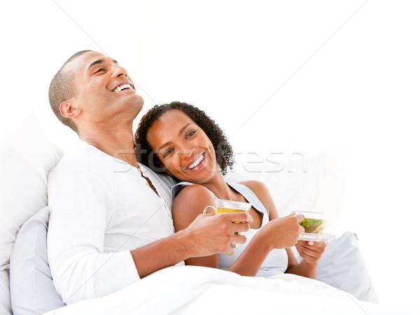 Alegre casal potável copo chá cama Foto stock © wavebreak_media