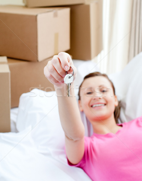 Lively woman relaxing on a sofa with boxes Stock photo © wavebreak_media