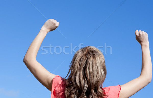 Happy woman punching the air outdoor Stock photo © wavebreak_media