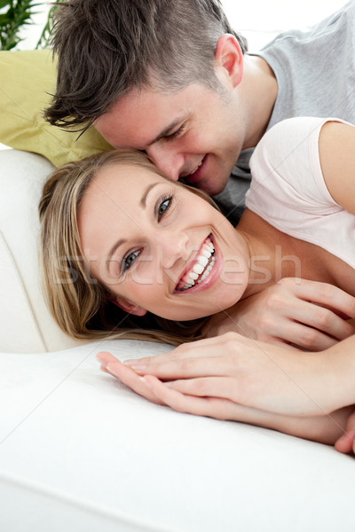 Young lovers having fun together on a sofa Stock photo © wavebreak_media
