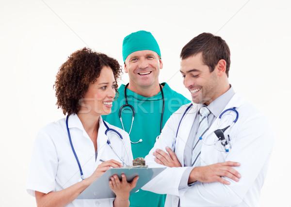 Cirujano debate sonriendo altos médicos blanco Foto stock © wavebreak_media