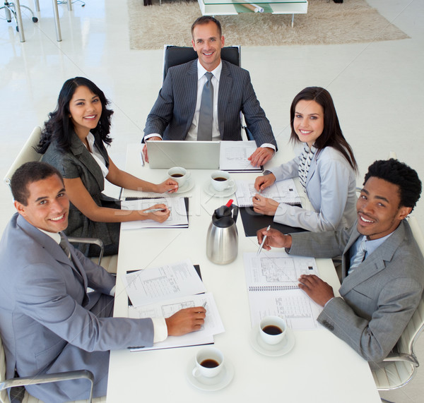 Multi-ethnic business people in a meeting smiling at the camera Stock photo © wavebreak_media