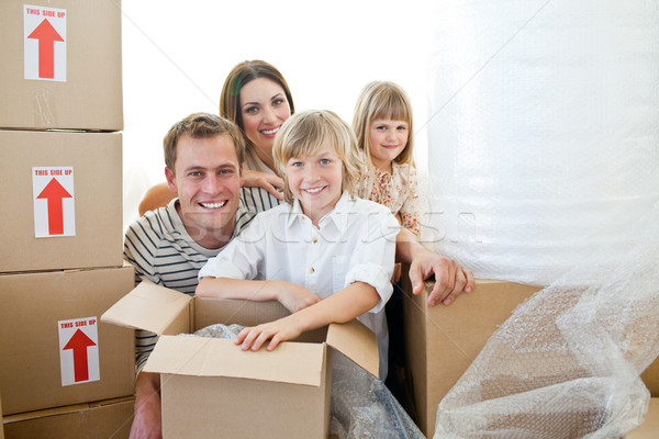 Loving family packing boxes while moving house Stock photo © wavebreak_media