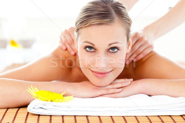 Portrait of a joyful woman lying on a massage table in a health spa Stock photo © wavebreak_media