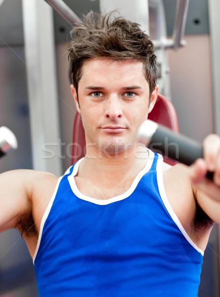 Encantador hombre banco prensa fitness Foto stock © wavebreak_media