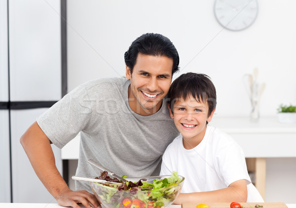 Portrait of a cute boy with his father in the kitchen for lunch  Stock photo © wavebreak_media