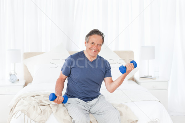 Stock photo: Senior do exercises at home