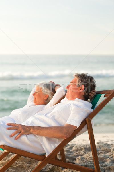 Ancianos Pareja relajante cubierta sillas mujer Foto stock © wavebreak_media
