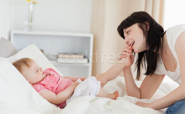 Jól kinéző barna hajú női játszik baba ül Stock fotó © wavebreak_media