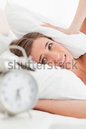 Közelkép nő ágy néz kamera hálószoba Stock fotó © wavebreak_media
