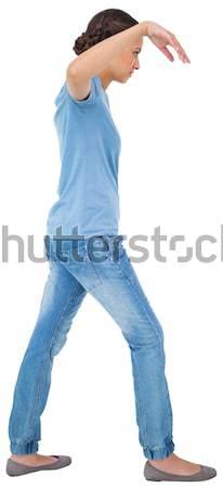 Joyful dark-haired man posing in a studio Stock photo © wavebreak_media