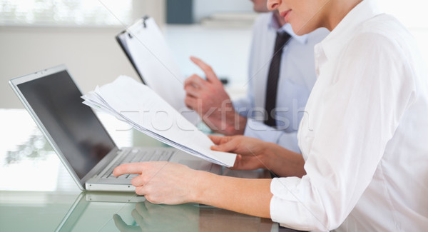 Office workers typing a report from blueprint documents in an office Stock photo © wavebreak_media