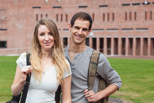 Cute student couple posing outside a building Stock photo © wavebreak_media