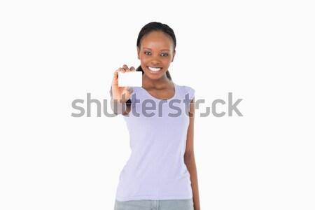 Glimlachende vrouw presenteren visitekaartje witte kaart presentatie Stockfoto © wavebreak_media